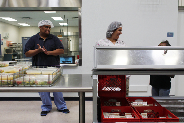 Ricky Wilson, left, and Deena Moore serve lunches Friday at Wendell P. Williams Elementary School in Las Vegas. A large gap exists between the number of children who receive free and reduced lunch ...