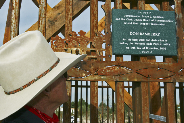 Don Bamberry stands beneath a plaque on Friday, Dec. 30, 2005, that credits him with the creation of the Western Trails Horse Park. (Shelly Donahue/View newspapers)