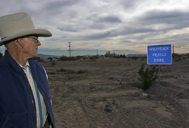 Don Bamberry looks at a Western Trails Park sign at the Western Trails Horse Park on Friday, Dec. 30, 2005. Bamberry has been recognized by the Clark County Board of Commissioners for the creation ...