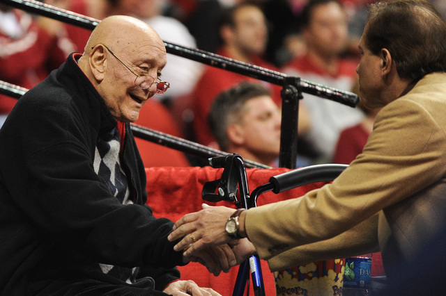 Former UNLV coach Jerry Tarkanian shakes hands with a fan on during a basketball game between the Rebels and Northern Arizona at Thomas & Mack Center Nov. 12, 2012. Tarkanian remains in intensive  ...