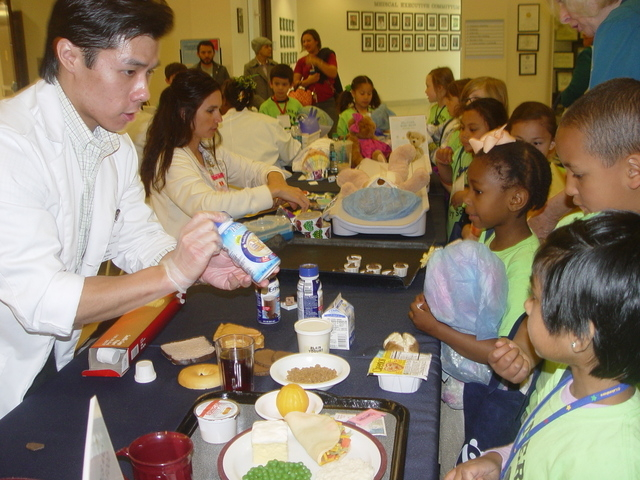 Michael Yuen, a University of Nevada student and Valley Hospital dietetic intern, shares healthy eating tips with students from Bonner Elementary School, 765 Crestdale Lane, April 4 during the ann ...