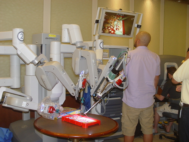 """Visitors to Summerlin Hospital's Teddy Bear Clinic take turns maneuvering the Da Vinci Robotic Surgical System while performing surgery on the childhood game """"Operation"""" April 4. (Special to View)"""