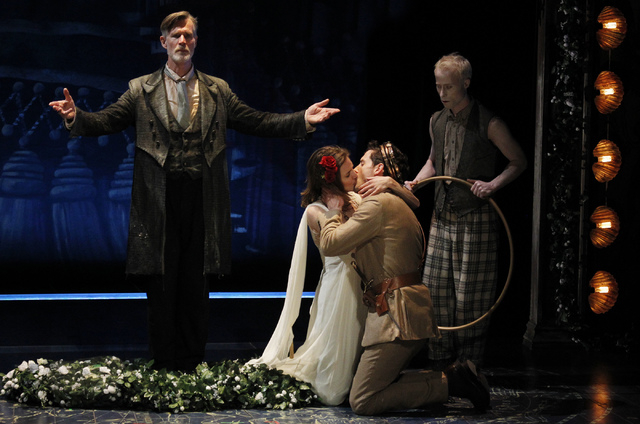 """Actors Charlotte Graham and Joby Earle kiss during a performance of """"The Tempest"""" at The Smith Center for the Performing Arts on Friday. Actors Nate Dendy, far right, and Tom Nelis are seen in the ..."""