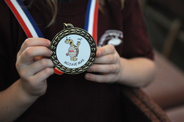 Peyton Burns displays her medal after being announced the winner of the Mojave Max contest during a surprise ceremony at Faith Lutheran Academy in Las Vegas Thursday, April 24, 2014. Burns won the ...