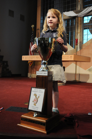 Peyton Burns poses for photos with the Mojave Max trophy after being announced the winner during a surprise ceremony at Faith Lutheran Academy in Las Vegas Thursday, April 24, 2014. Burns, a first ...