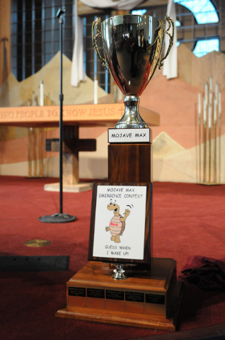 The Mojave Max winner trophy is displayed during a surprise ceremony at Faith Lutheran Academy in Las Vegas where the winner was announced Thursday, April 24, 2014. Peyton Burns, a first grader at ...