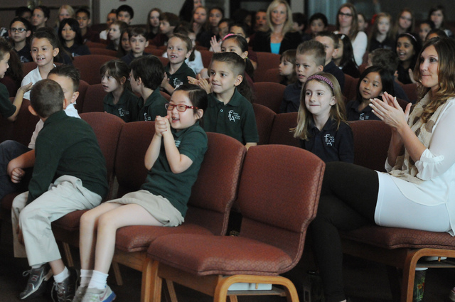 Students react after their first grade classmate Peyton Burns was announced the winner of the annual Mojave Max contest during a surprise ceremony at Faith Lutheran Academy in Las Vegas Thursday,  ...