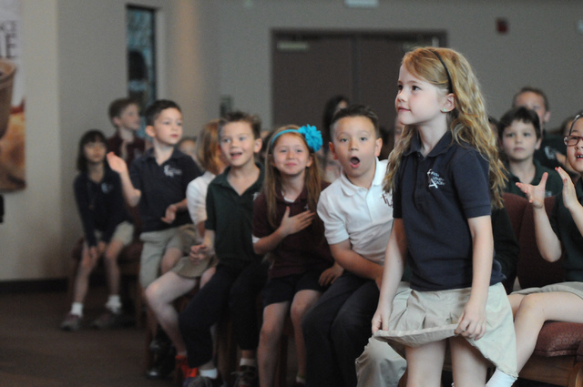 First grader Peyton Burns, right, is announced the winner of the annual Mojave Max contest during a surprise ceremony at Faith Lutheran Academy in Las Vegas Thursday, April 24, 2014. Burns won the ...