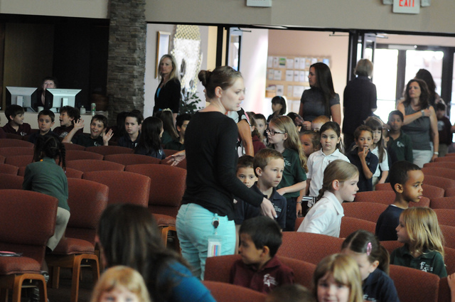 Students are directed to their seats during a surprise ceremony to announce the winner of the annual Mojave Max contest at Faith Lutheran Academy in Las Vegas Thursday, April 24, 2014. Peyton Burn ...