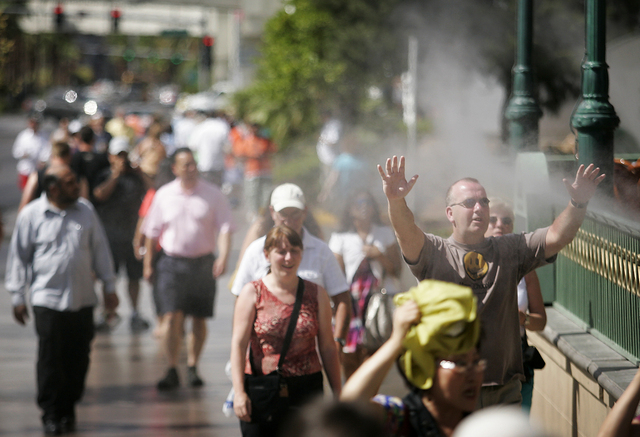 A pedestrian on the Strip takes advantage of misters to cool off outside the Paris Las Vegas hotel-casino on Wednesday, June 9, 2010, in Las Vegas. (JASON BEAN/LAS VEGAS REVIEW-JOURNAL