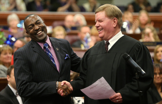 Nevada Assemblyman Tyrone Thompson, D-North Las Vegas, left, is congratulated by Supreme Court Associate Chief Justice Mark Gibbons after taking the oath of office at the Legislative Building in C ...
