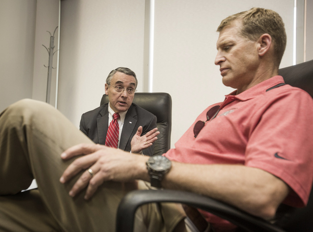 UNLV President Donald Snyder, left, and UNLV Men's Football Coach Bobby Hauck shown during a press conference at Thomas and Mack Center on Thursday. The school announced today that it's football p ...