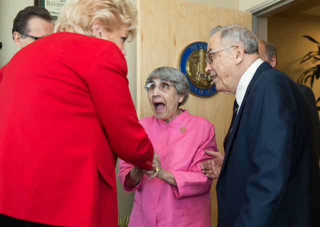 Flossie Vallen, center, greets Las Vegas Mayor Carolyn Goodman, left, Thursday, April 10, 2014 at City Hall before a proclamation to declare this week UNLVino Week. At right is Vallen's husband, J ...