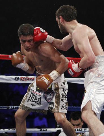 Khabib Allakhverdiev hits Jessie Vargas during their WBA Super Lightweight Title bout at the MGM Grand in Las Vegas Saturday, April 12, 2014. (John Locher/Las Vegas Review-Journal)