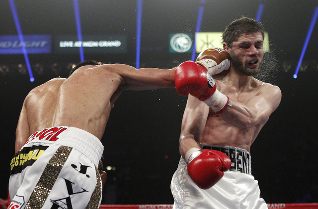 Jessie Vargas hits Khabib Allakhverdiev during their WBA Super Lightweight Title bout at the MGM Grand in Las Vegas Saturday, April 12, 2014. (John Locher/Las Vegas Review-Journal)