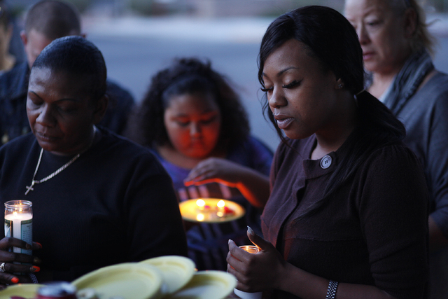 Jamie, who declined to give her last name, says a prayer during a candlelight vigil at University Medical Center Thursday for a seventh-grade student who was hospitalized Wednesday after a fight a ...