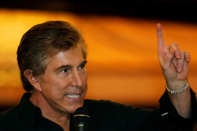 Las Vegas casino mogul Steve Wynn gestures during a news conference in this file photo.  (AP Photo/Kin Cheung)