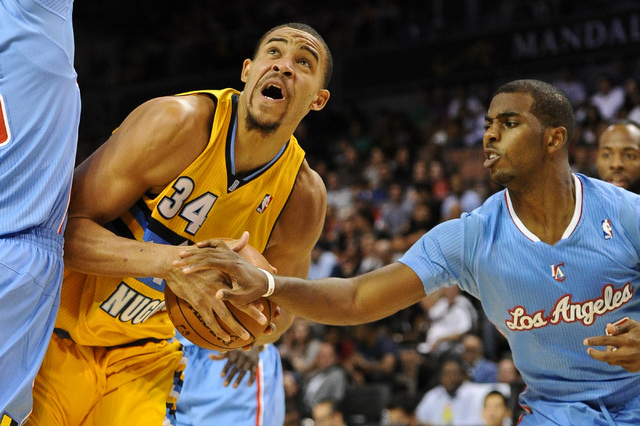 Los Angeles Clippers guard Chris Paul defends against Denver Nuggets center JaVale McGee during an NBA preseason basketball game at Mandalay Bay in Las Vegas on Oct. 19, 2013.  The Clippers-Nugget ...