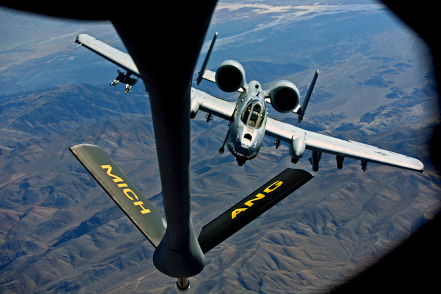An A-10 Thunderbolt attack jet, affectionately known as the Warthogs, flies behind a Michigan Air National Guard KC-135T Stratotanker during a Green Flag exercise over the Mojave Desert near Fort  ...