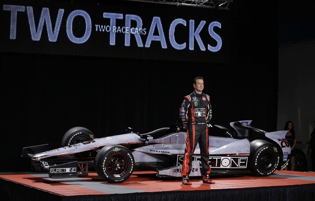NASCAR driver Kurt Busch stands in front of his newly unveiled IndyCar entry for the Indianapolis 500 during an announcement in Indianapolis, Monday, April 28, 2014. Busch will try to be the first ...