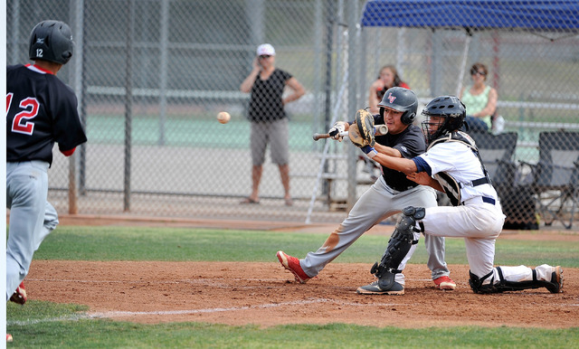 Shadow Ridge catcher Robbie Galvan steps forward to grab the ball as Las Vegas' Kyle Christensen (12) races home on an attempted squeeze play with Las Vegas' Jose Sanchez on Tuesday. Christensen w ...