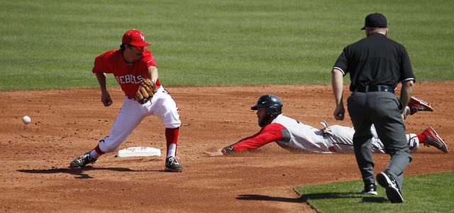 UNLV shortstop Matt McCallister (4) can't field a throw from catcher Erik VanMeetren as San Diego State's Tim Zier steals second during a Mountain West game at Wilson Stadium on March 22. The  ...