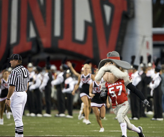 """The """"Hey Reb"""" mascot, followed by cheerleaders, run onto the field before UNLV takes on Utah State in a Mountain West Conference football game at Sam Boyd Stadium in this file photo. (Review-Journ ..."""