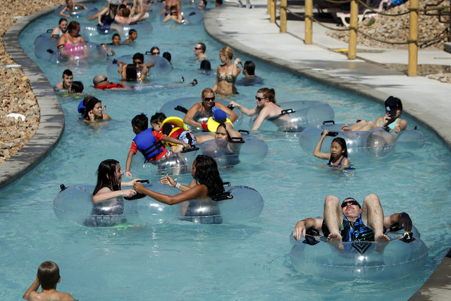 People float along the lazy river at Wet 'n' Wild Las Vegas water park on June 8, 2013. The park opens for the season this Saturday. (John Locher/Las Vegas Review-Journal)