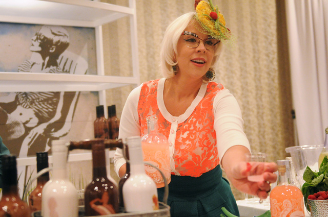 Emily Ellyn, mixes drinks for LiDestri Spirits at their booth during the Wine & Spirits Wholesalers of America's 71st annual convention at the Caesars Palace in Las Vegas Tuesday, April 8, 2014. ( ...