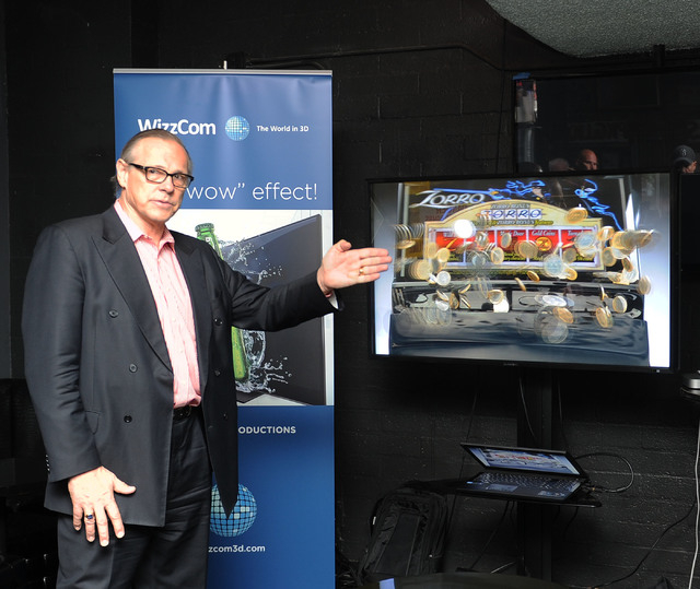 WizzCom 3D Productions President and CEO Anders Mjardsjo demonstrates 3-D effects on a monitor as the system is previewed in Atomic Liquors on Wednesday. The company's plans include building a stu ...