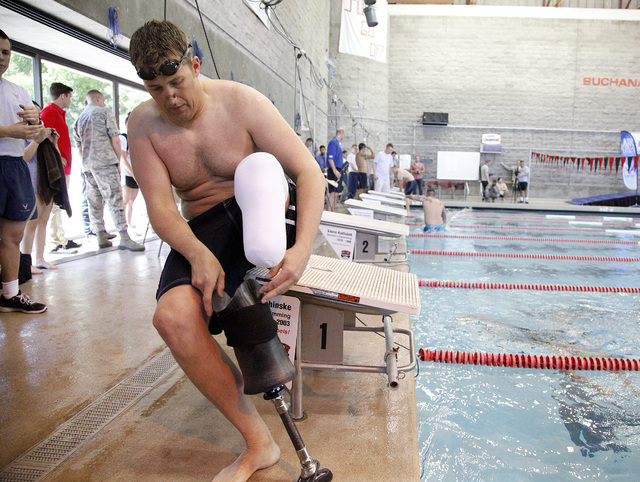 Army Master Sergeant Dan Hendrix of Colorado Springs, Colo., prepares to enter the pool before his 50-meter race during the inaugural Air Force Trials at the Buchanan Natatorium on the campus of U ...