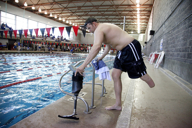 Army Master Sergeant Dan Hendrix, of Colorado Springs, Colo., enters the pool before the start of the inaugural Air Force Trials at the Buchanan Natatorium on the campus of UNLV on Monday. Hendrix ...