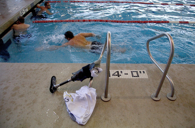 Army Master Sergeant Dan Hendrix of Colorado Springs, Colo., swims before the start of the inaugural Air Force Trials at the Buchanan Natatorium on the campus of UNLV on Monday. Hendrix lost his l ...