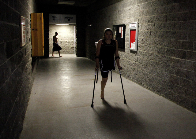 Athletes exit the locker rooms before the start of  the inaugural Air Force Trials at the Buchanan Natatorium on the campus of UNLV on Monday. These trials are to qualify for the 2014 Warrior Game ...