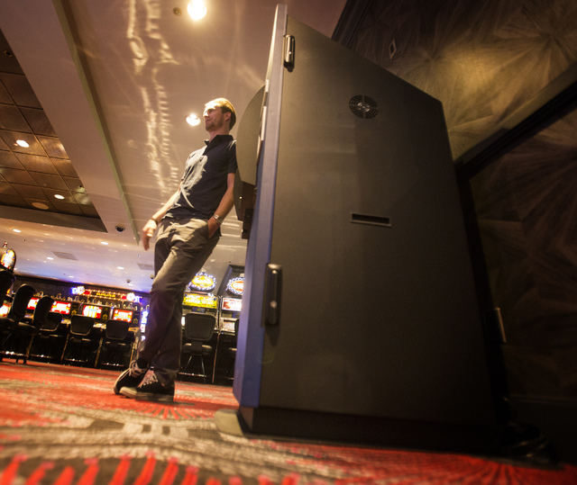 Robocoin CEO Jordan Kelley leans against Bitcoin ATM at the The D, 301 Fremont Street, on Wednesday, May 21, 2014. The Las Vegas-owned Robocoin is launching its ATM in Las Vegas at the hotel. (Jef ...