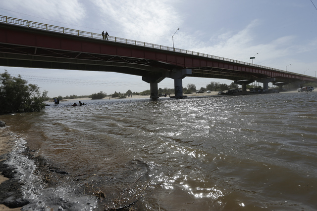 Water flows in a usually dry riverbed Wednesday, March 26, 2014, in San Luis Rio Colorado, Mexico. Colorado River water has begun pouring over a barren delta near the U.S.-Mexico border, the resul ...