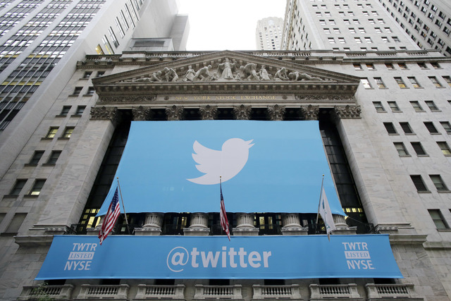FILE - In this Thursday, Nov. 7, 2013 file photo, a banner with the Twitter logo hangs on the facade of the New York Stock Exchange in New York the day after the company went public. Stocks are do ...