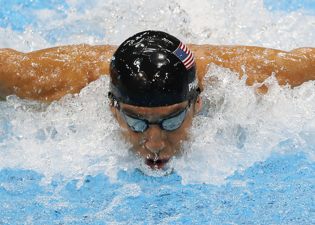 United States' Michael Phelps swims in the men's 4 X 100-meter medley relay at the Aquatics Centre in the Olympic Park during the 2012 Summer Olympics in London. Phelps is coming out of retirement ...
