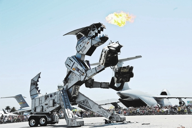 "Robosaurus bites a car in half during ""Thunder Over The Empire Airfest"" at March Air Reserve Base, Ca., May 20, 2012. Airfest 2012 features military and civilian ground and aerial demons ..."
