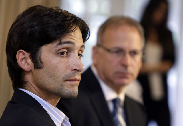 Plaintiff Michael Egan, left, with his attorney, Jeff Herman take questions from to the media during a news conference in Beverly Hills, Calif., Thursday, April 17, 2014. A sex abuse lawsuit by Eg ...