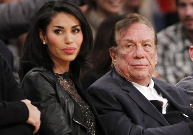 In this Dec. 19, 2010, file photo, Los Angeles Clippers owner Donald Sterling, right, and V. Stiviano, left, watch the Clippers play the Los Angeles Lakers during an NBA preseason basketball game  ...