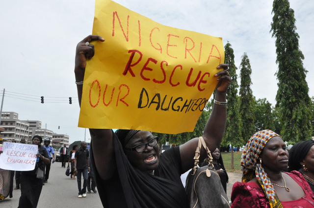 An unidentified mother cries out during a demonstration with others who have daughters among the kidnapped school girls of government secondary school Chibok, Tuesday April 29, 2014, in Abuja, Nig ...