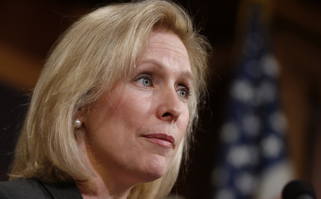 FILE - This March 6, 2014 file photo shows Sen. Kirsten Gillibrand, D-N.Y. on Capitol Hill in Washington. The Education Department on Thursday took the unprecedented step of releasing the names of ...