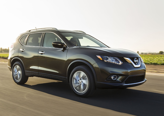 This undated product image provided by Nissan North America shows the 2014 Nissan Rogue small SUV. American car buyers came out of hibernation in April to spend on pickup trucks and SUVs, fueling  ...