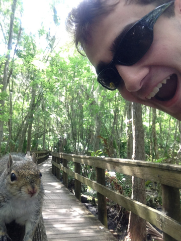 In this photo made Saturday April, 26, 2014, and provided by Brian Genest, a squirrel approaches Brian Genest as he takes a photo of himself at John Chestnut Park near Tampa, Florida. Genest, 17,  ...