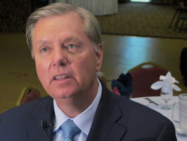 In this Sept. 3, 2013 file photo Sen. Lindsey Graham, R-S.C.  talks to a reporter following a speech in Goose Creek, S.C. The White House on Wednesday April 30, 2014 denied that a staff members em ...