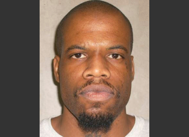 This June 29, 2011 file photo provided by the Oklahoma Department of Corrections shows Clayton Lockett. Oklahoma prison officials halted the execution of Lockett Tuesday, April 29, 2014,  after th ...