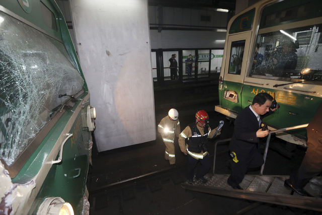 Windows of two subway trains remain broken after their collision at Sangwangshipri subway station in Seoul, South Korea, Friday, May. 2, 2014. A subway train plowed into another train stopped Frid ...