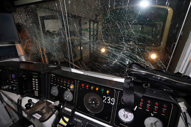 A window of a subway train is broken after a collision at Sangwangshipri subway station in Seoul, South Korea, Friday, May. 2, 2014. A subway train plowed into another train stopped at the station ...