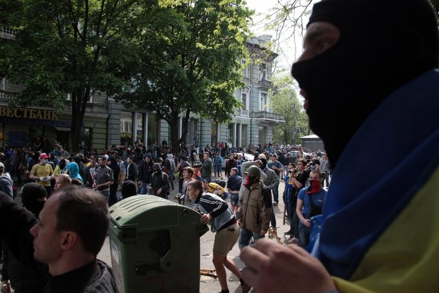 Ukrainian government supporters clash with pro-Russians in the Black Sea port of Odessa, Ukraine, Friday, May 2, 2014. A clash broke out late Friday between pro-Russians and government supporters  ...